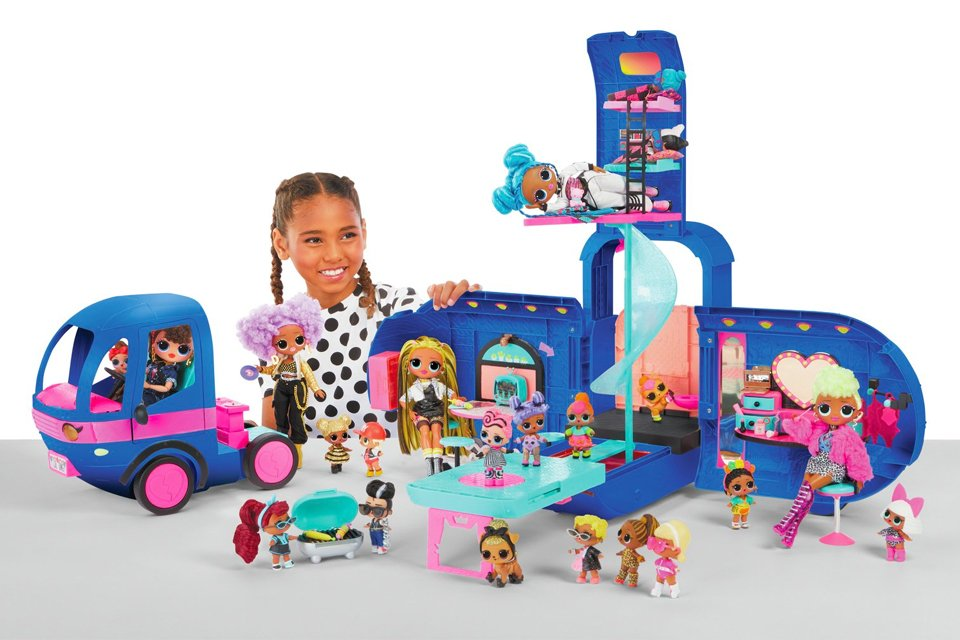 Girl playing with opened out L.O.L. glamper playset