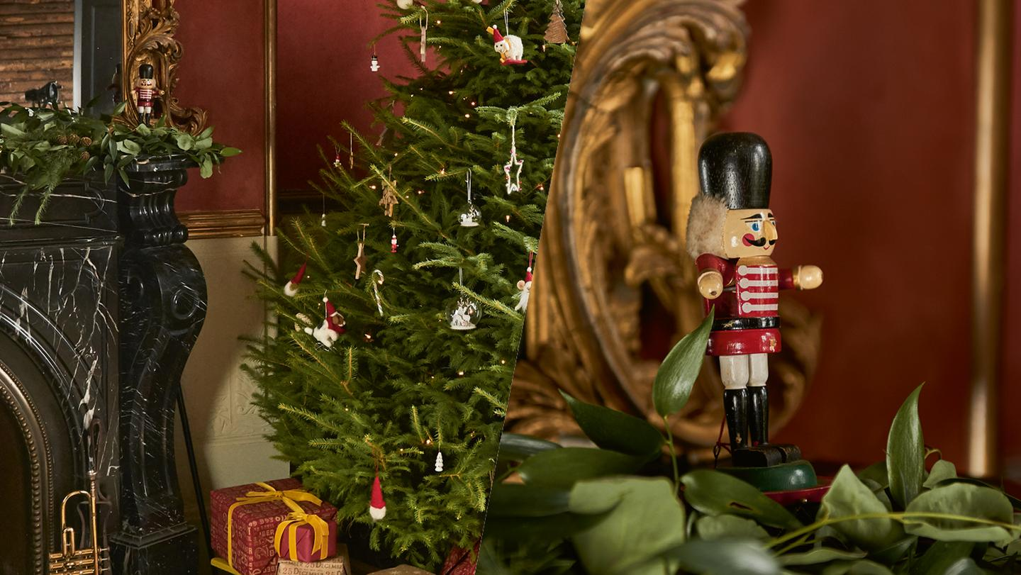 a beautifully decorated christmas tree and traditional wooden nutcracker
