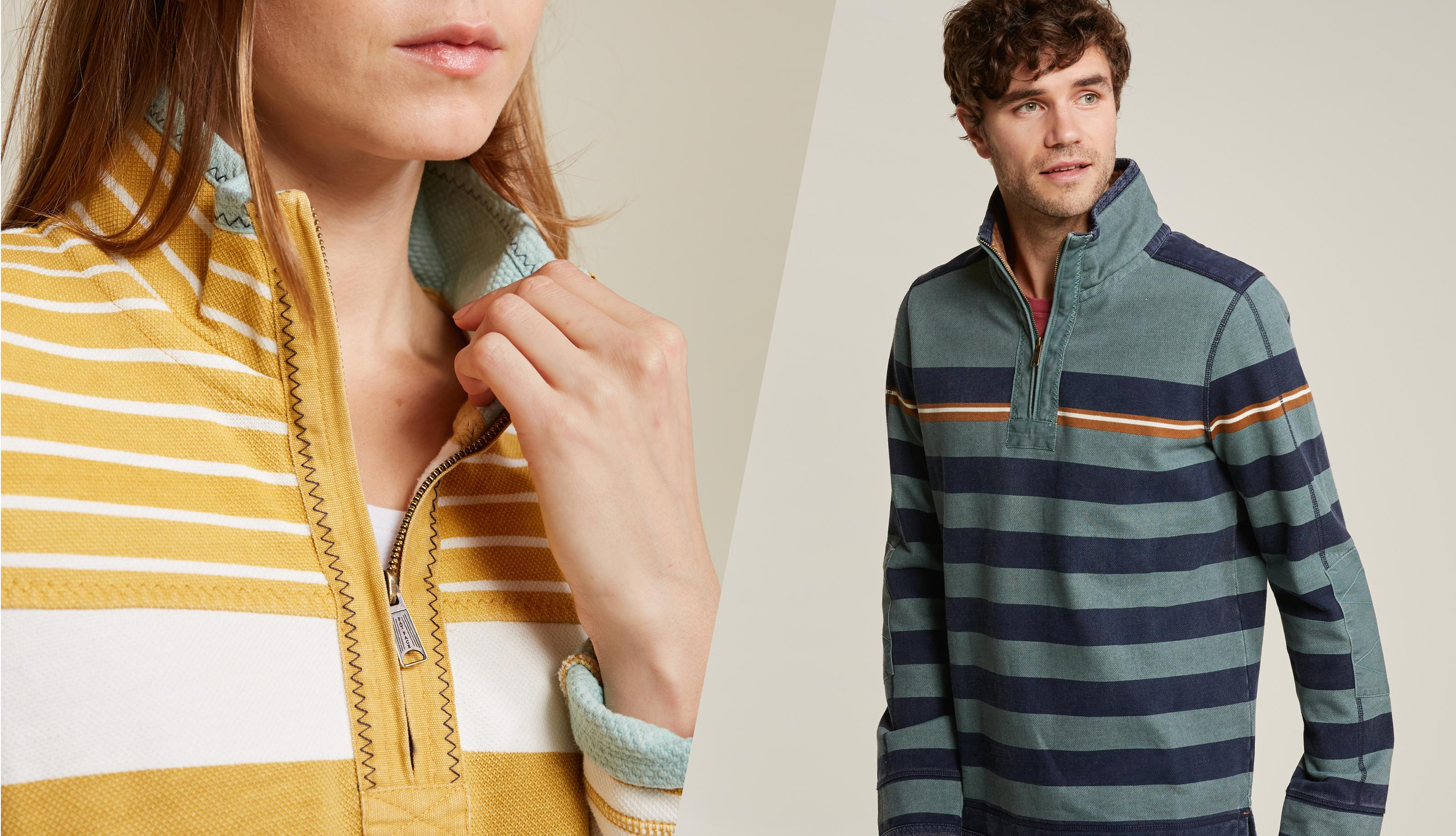 A close up of a female model weaing a yellow stripe Airlie sweatshirt and a male model wearing a green and black stripe Airlie sweatshirt.