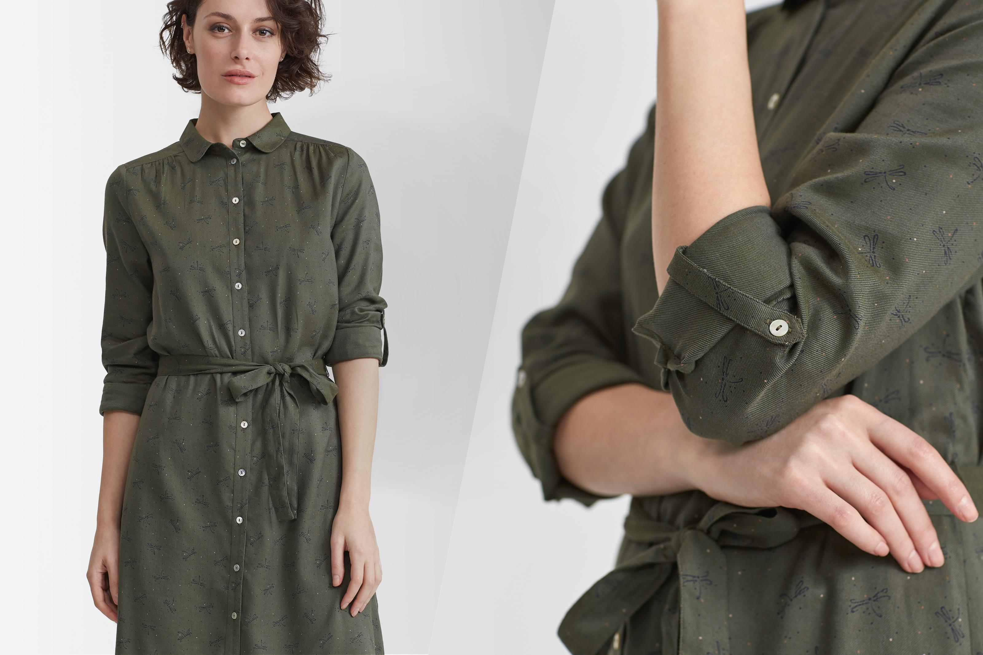 Female model wearing a khaki shirt dress with a embroidered khaki print.