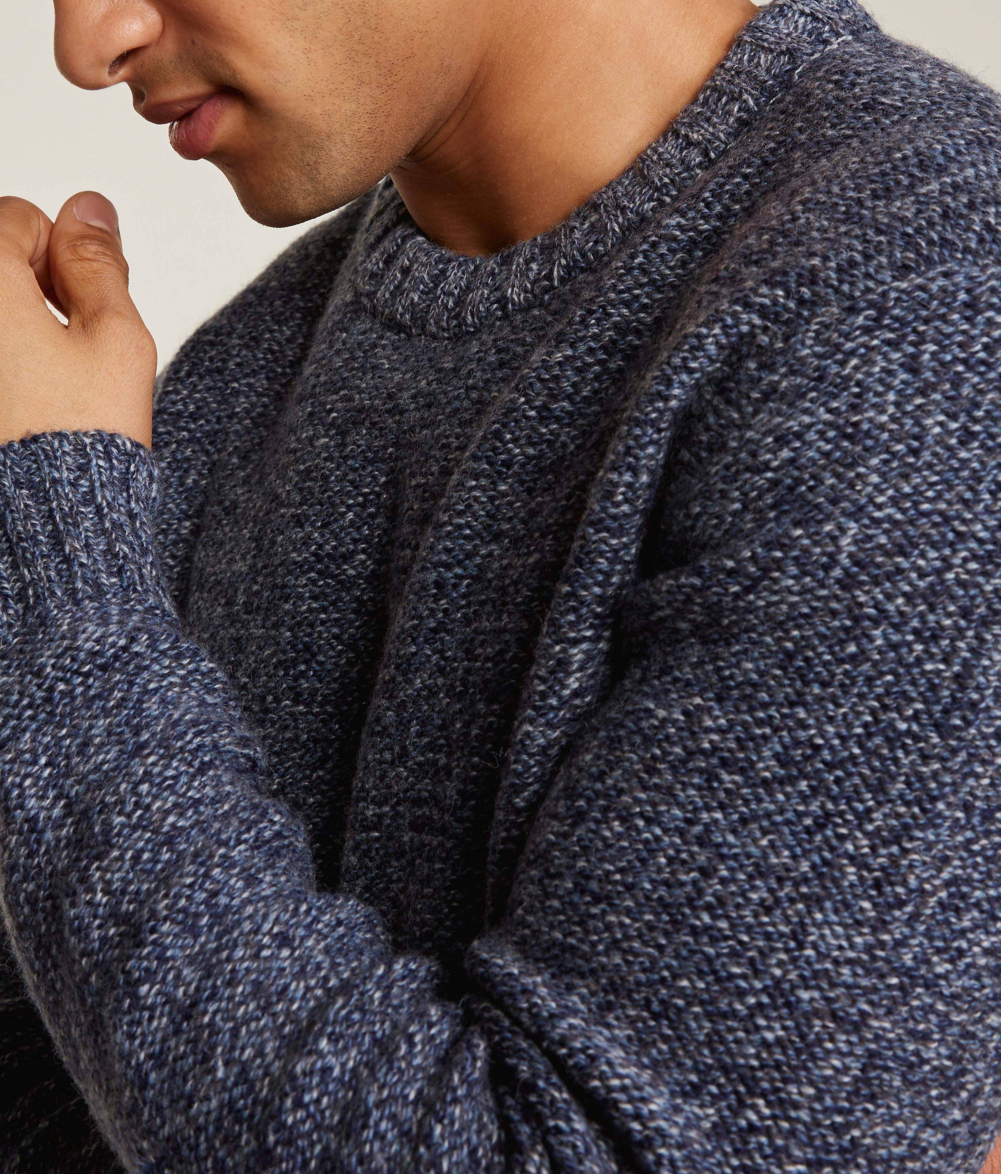 Close up of a blue knit jumper.