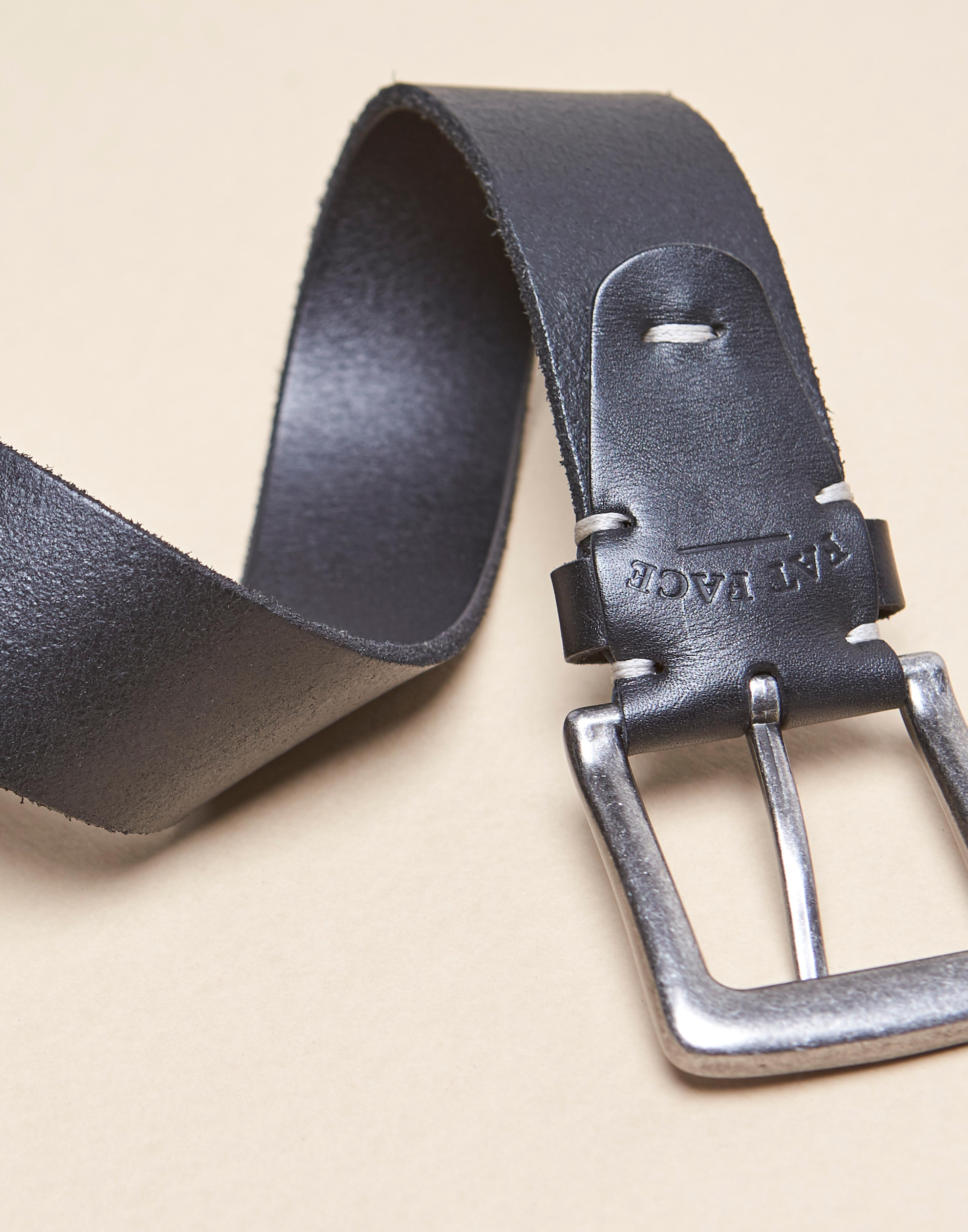 Close up of a black leather belt.