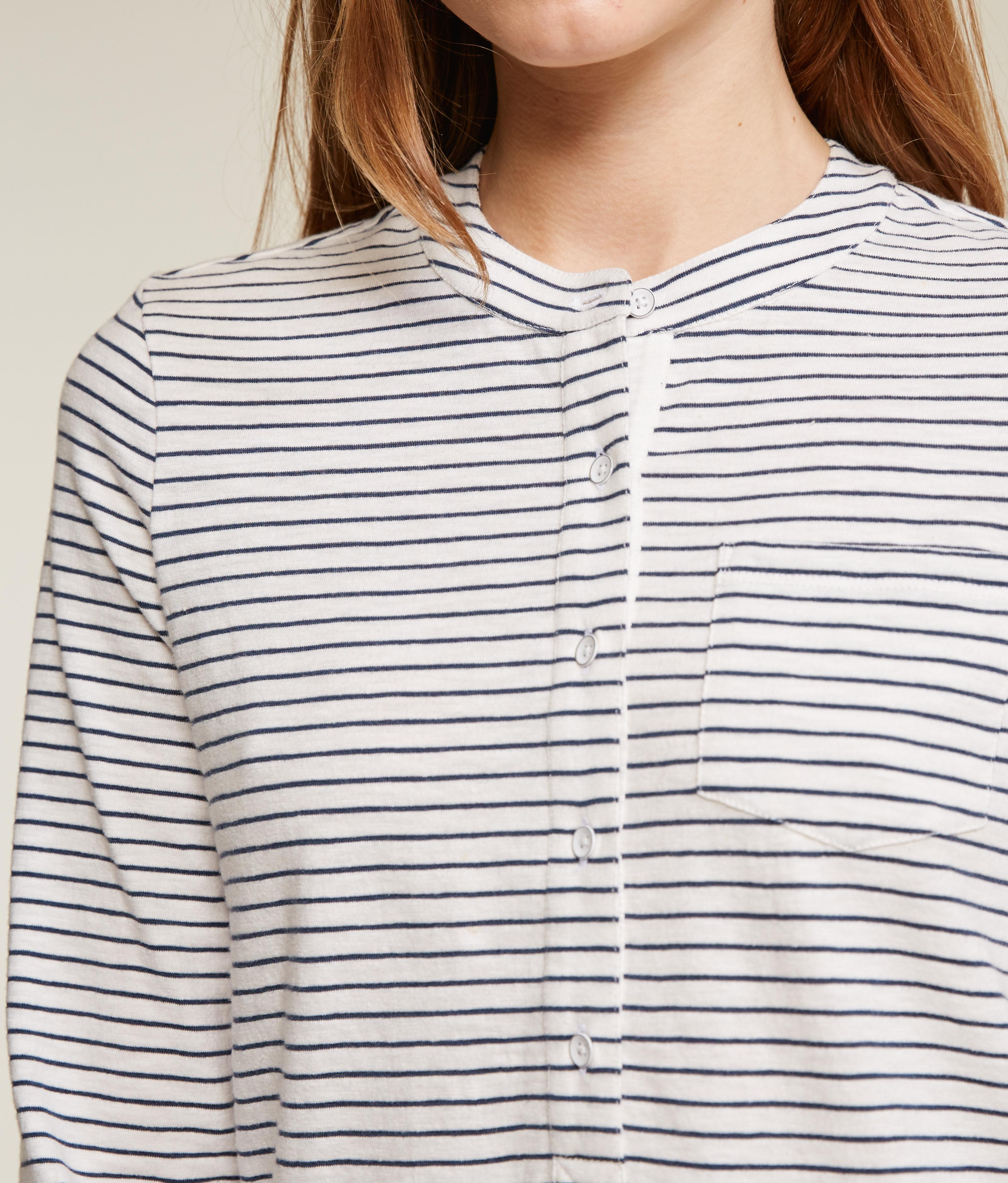 Close up of a white and black fine striped top.