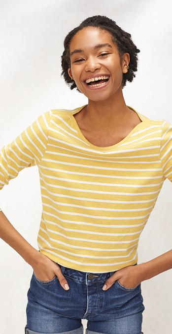 Female model wearing the organic cotton breton t-shirt in daffodil