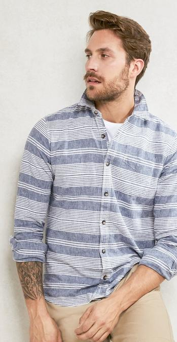 Male model wearing the Seabrook Stripe Shirt in chambray over the white hawnby organic cotton crew neck t-shirt with stone chinos