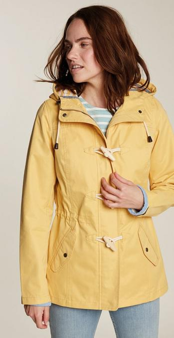 Female model wearing the Roseanne Jacket in daffodil