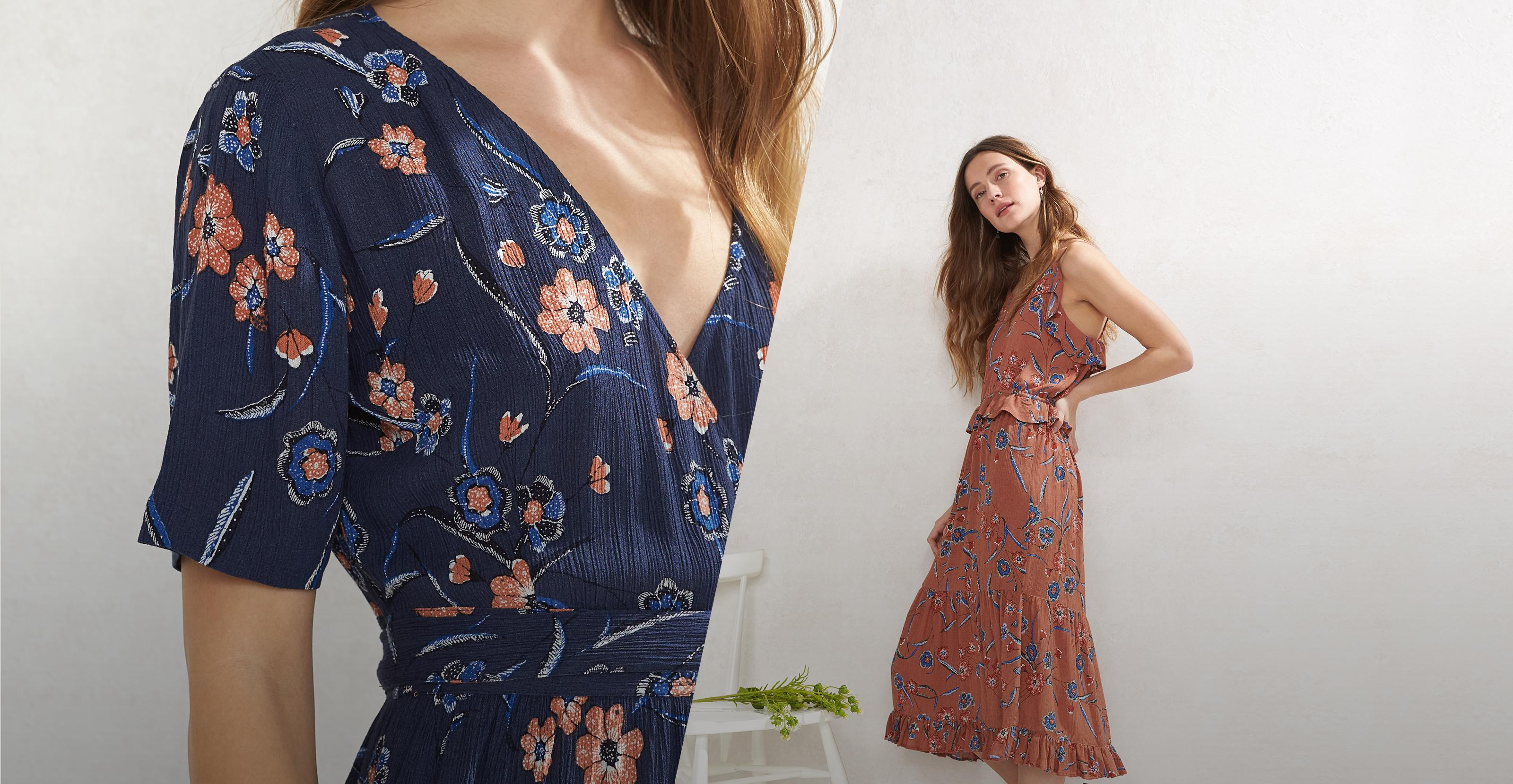 Split image of a woman FatFace model wearing a indigo Sunset Floral Willa Wrap Dress and a model wearing a terracotta Sunset Floral Dress.