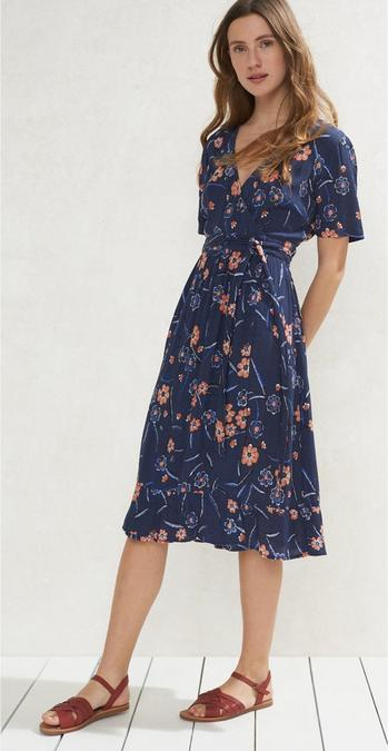 Female model wearing the Willa Sunset Floral Midi Dress