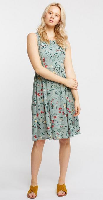 f45e39b54d2 Female model wearing the Karen Harvest Floral Dress in mint with the Star  drop earrings