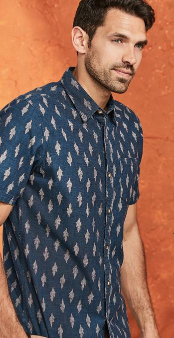 Male FatFace model wearing a navy Ikat Print Shirt