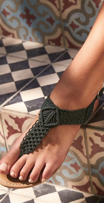 Close up of a model wearing Clara Crochet Sandals in khaki.