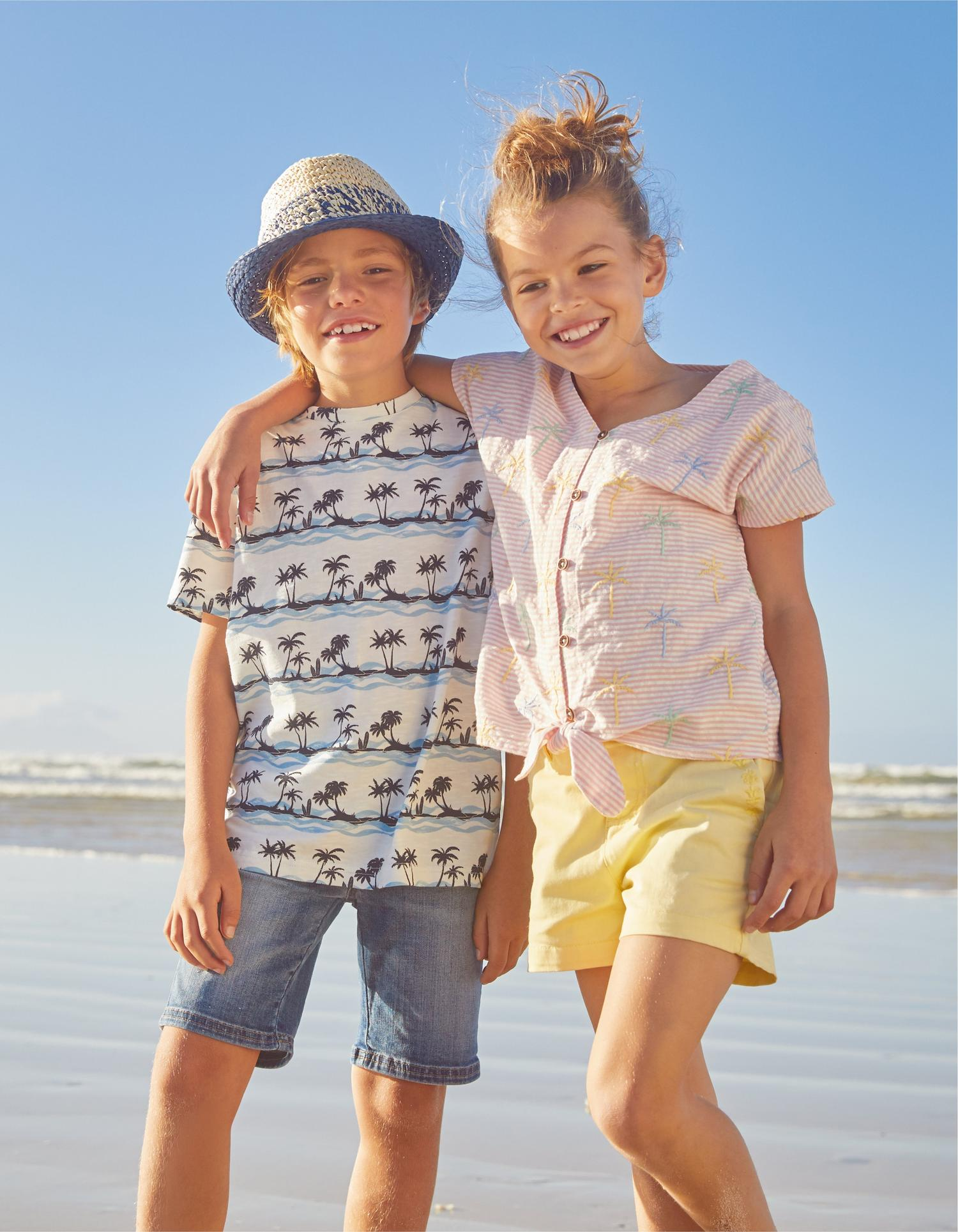 Group shot of a girl and boy fatface model wearing shorts and tee shirts