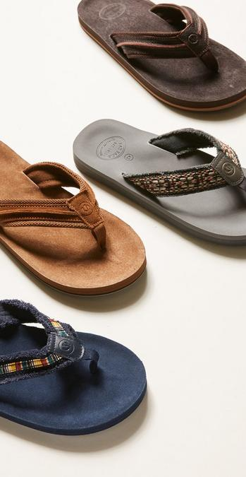 Image of 4 flip flops showing range of colours, blue, light brown, grey and dark brown.