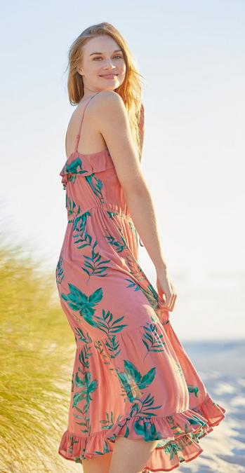 96a8ece8b5 Fatface female model in our miami print dress on the beach.