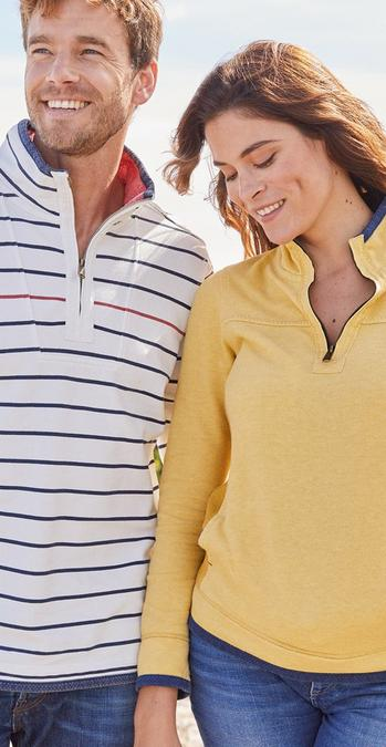Fatface male and female models wearing our Airlie sweats. Male model in white and blue stripes, female in yellow.