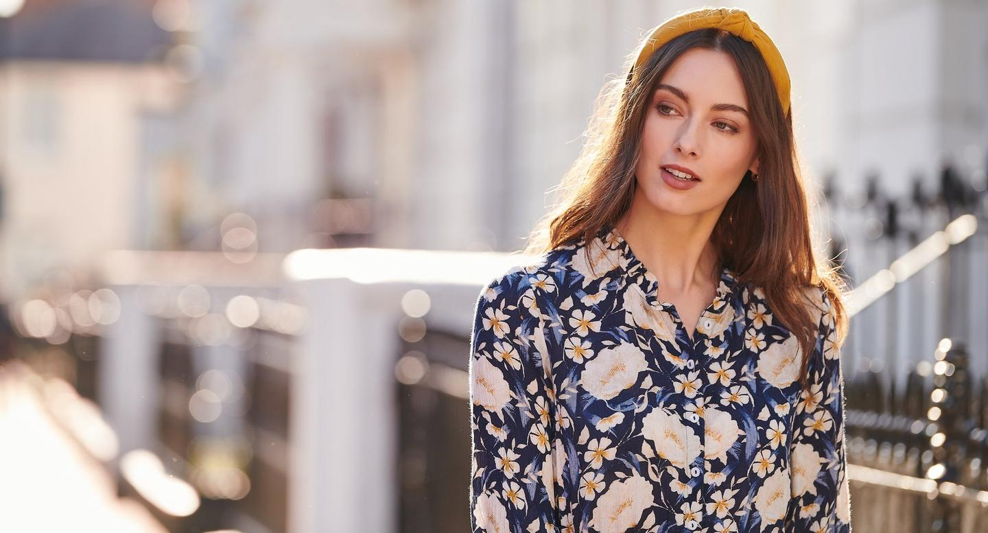 Female FatFace model wearing the Autumn Blooms Shirt Dress with a mustard yellow knot headband.