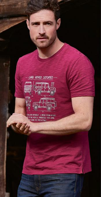 Male model wearing a burgundy graphic t-shirt with a land rover graphic.