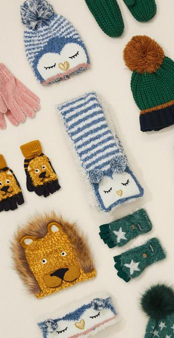 Selection of fun hats, scarves and gloves in different colours and designs.