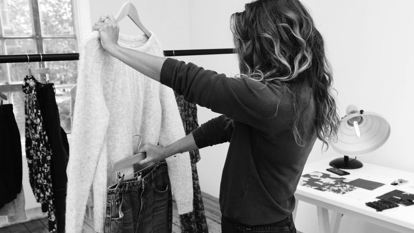Three black and white image of Angie Smith a UK stylist working for FatFace, styling clothes.