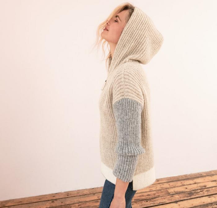 A blonde female model wearing the Lola Colour Block Hoody, part of the stylist edit by Angie Smith