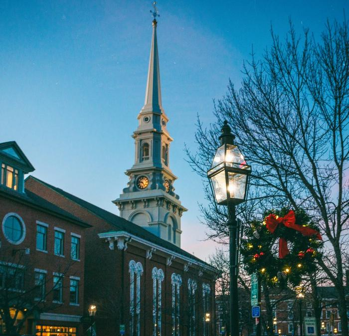 The historic port town of Portsmouth, New Hampshire with Christmas lights.