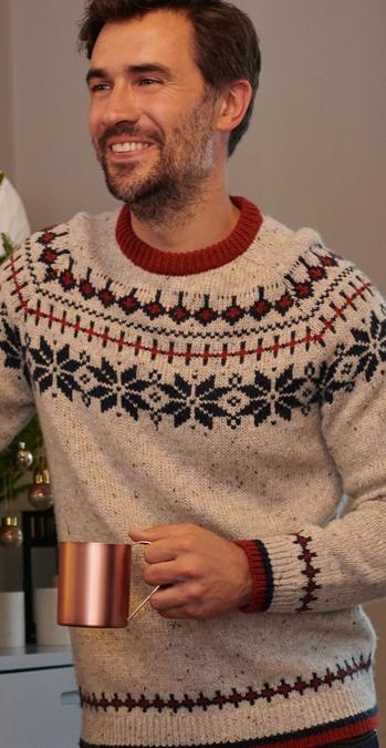 Male model wearing a ivory and navy fairisle jumper.