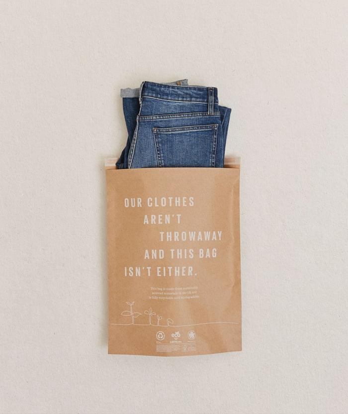 A pair of jeans placed into our new sustainable packaging.