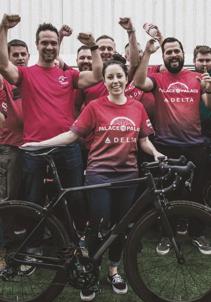 The FatFace team wearing red Palace to Palace jersey tops, who cycled 45 miles each for charity.