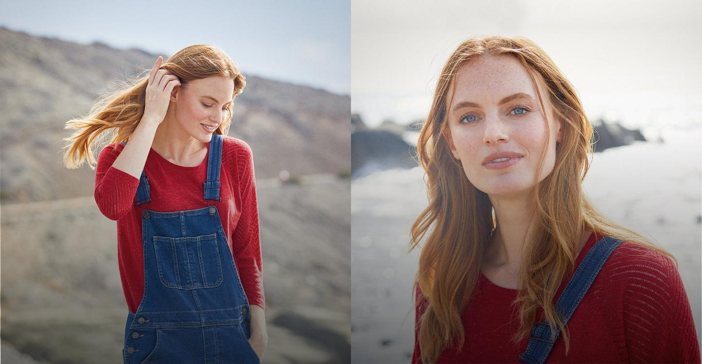 Female model wearing denim dungarees over a red ribbed jumper.