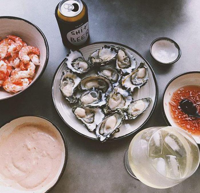 Bowls of seafood, including oysters and prawns.