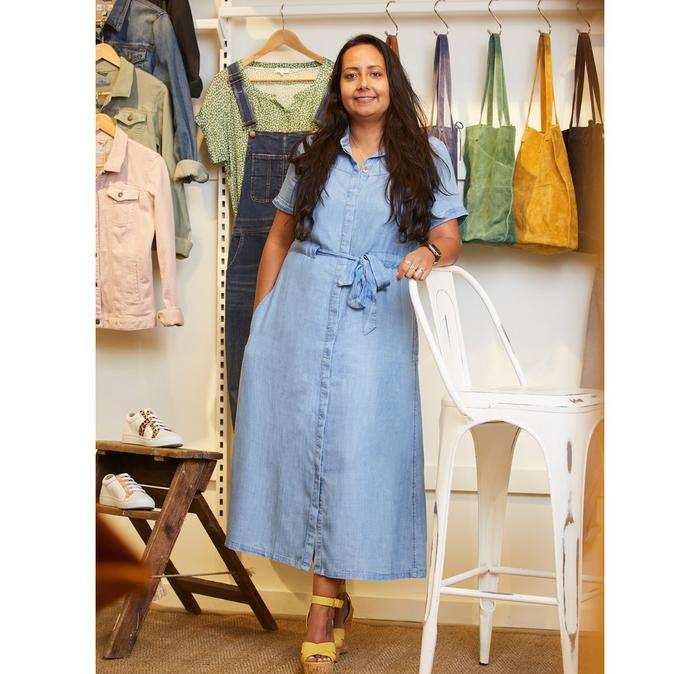 Jo, who is the Head of Retail Operations at FatFace, wears a chambray shirt dress.