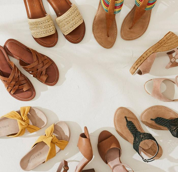 A selection of women's sandals in a circle.