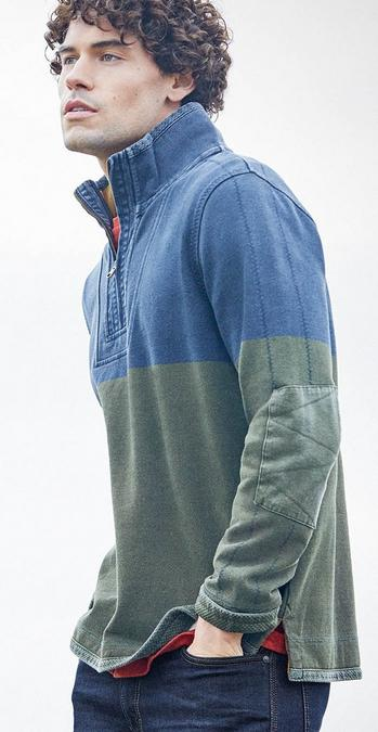 a male model wearing navy and green half neck Airlie Sweatshirt.