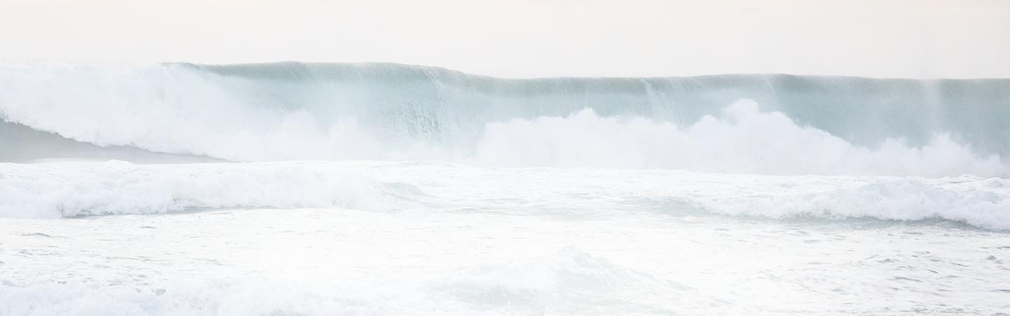 A large wave breaking on a beach