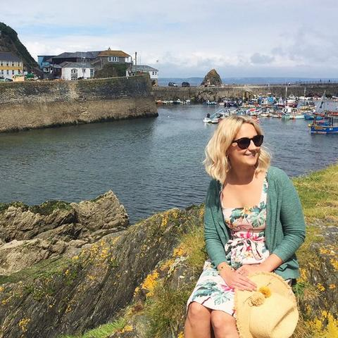 The beautiful port of Mevagissey in Cornwall, where Eliza from the FatFace store in the area is visiting while wearing FatFace clothes