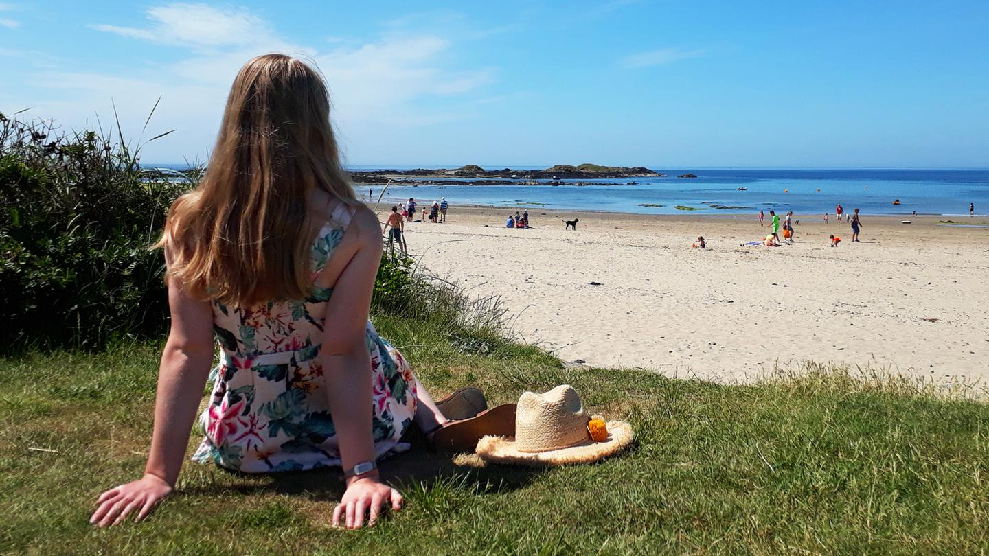 fe3393fe50 A FatFace crew member from Rhosneigr, chilling on the beach in the Serena  Tropical Dress