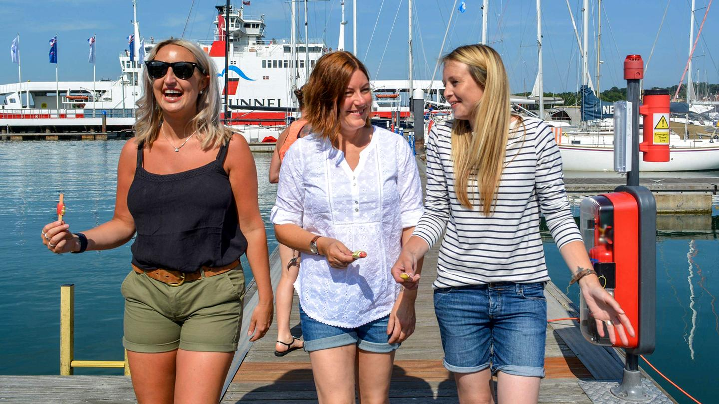 18979630f9 Crew from the FatFace store in Cowes, enjoying a day out by the water  wearing
