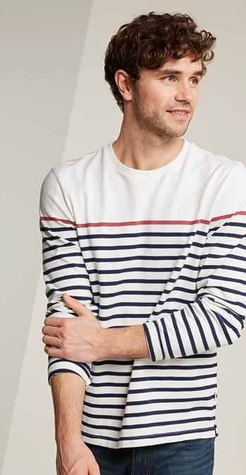 Male FatFace model wearing a ecru long sleeve top with navy stripes.