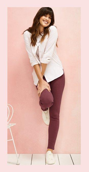 Female model wearing the pink Olivia Stripe Shirt and the pink Sadie Skinny Trousers on a pink background