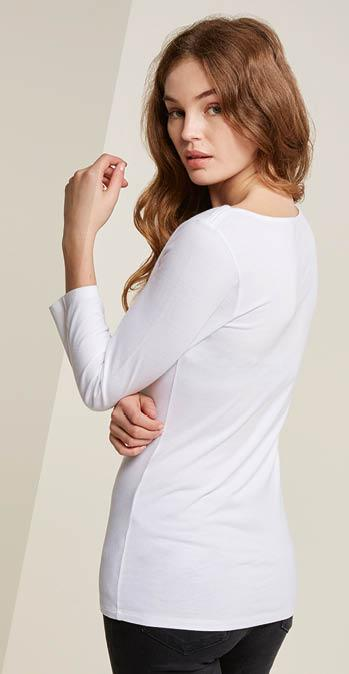 Woman FatFace model with her back turned wearing a long sleeve white t-shirt.