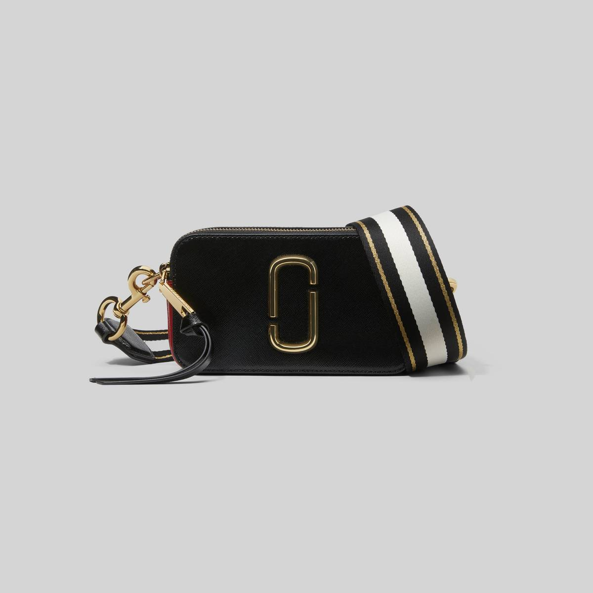 Bold and compact, our best-selling Snapshot Small Camera Bag keeps all the important stuff organized without missing a beat. Take this from your daily commutes to your next vacayitll perk up your look wherever you end up. | MARC JACOBS Women\\'s The Snapshot Bag in Black/Red