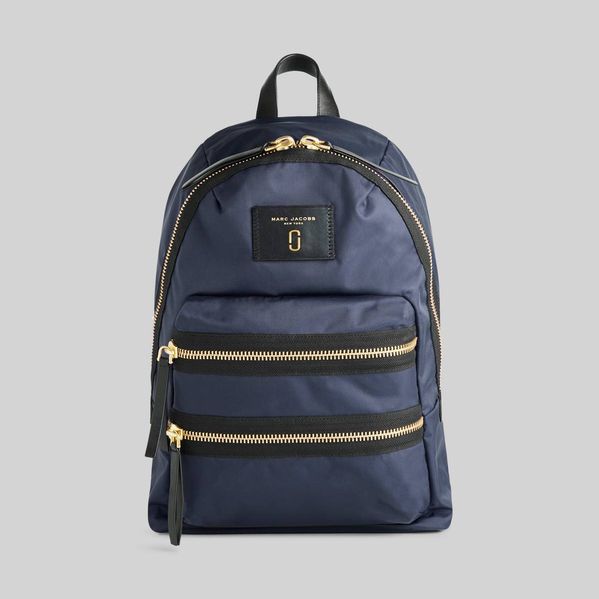 The backpack of all trades returning this season in a lightweight, high-performance nylon. Our signature dual exterior zip adds functionality while smooth padded straps allow for all day wear no matter where the week takes you. | MARC JACOBS Women\\'s Nylon Biker Backpack in Midnight Blue