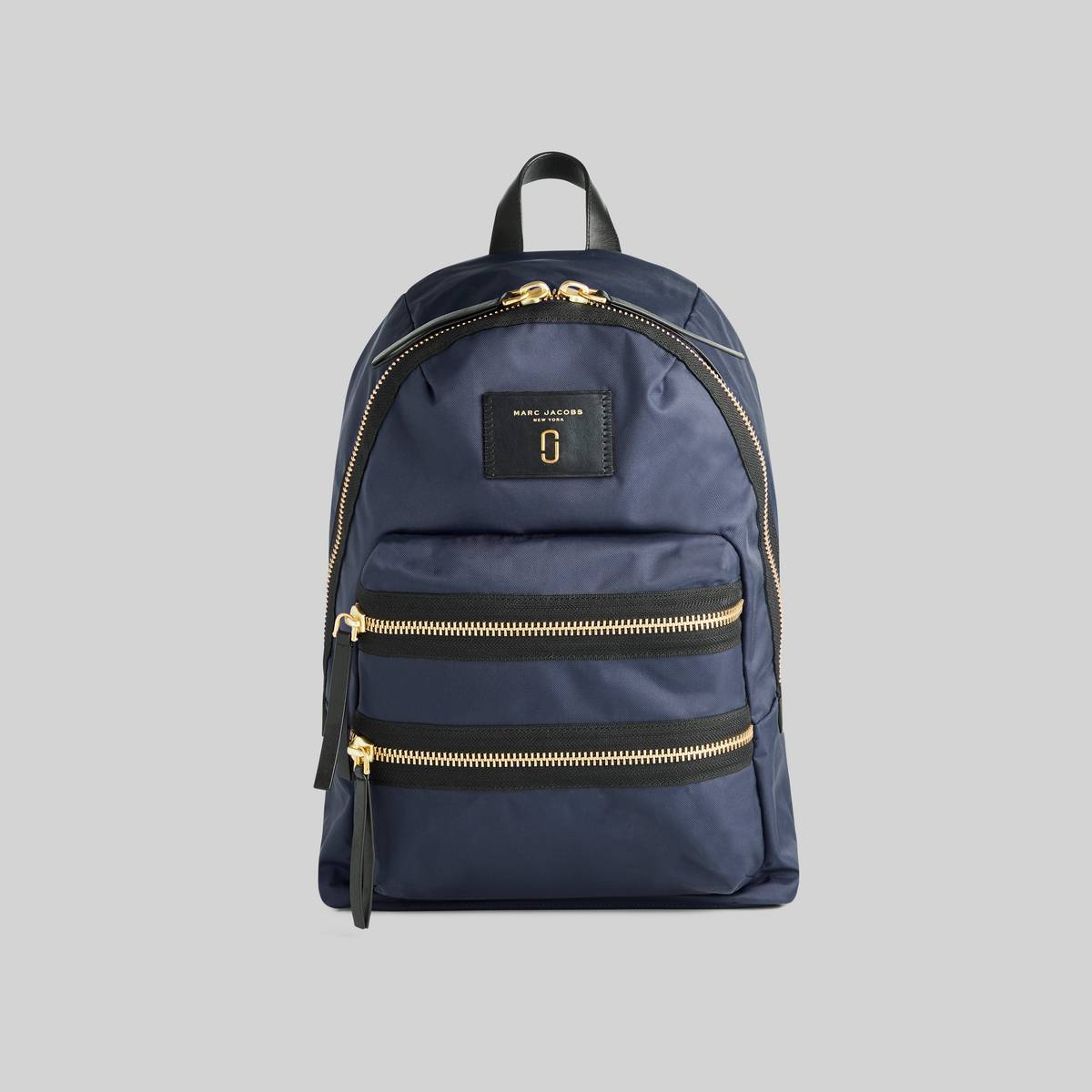 The mini backpack of all trades returning this season in a lightweight, high-performance nylon. Our signature dual exterior zip adds functionality while smooth padded straps allow a comfortable transition from day to night. | MARC JACOBS Women\\'s Nylon Biker Mini Backpack in Midnight Blue