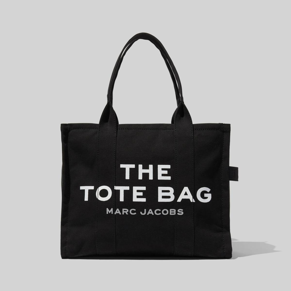 Large canvas tote featuring screen printed logo and top zipper closure. | MARC JACOBS Women\\'s The Traveler Tote Bag in Black