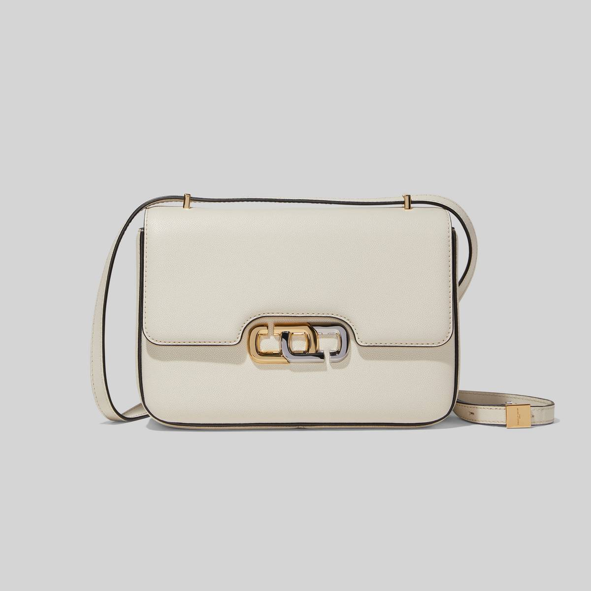 Expect the unexpected from this classic structured shoulder bag with just the right amount of edge. Marked by the contrast between its bungee cord knot detail and refined leather and shape, The J Link features our signature double J, reoriented and reimagined in interlocked mixed metals. | MARC JACOBS Women\\'s The J Link Classic Bag in Ivory
