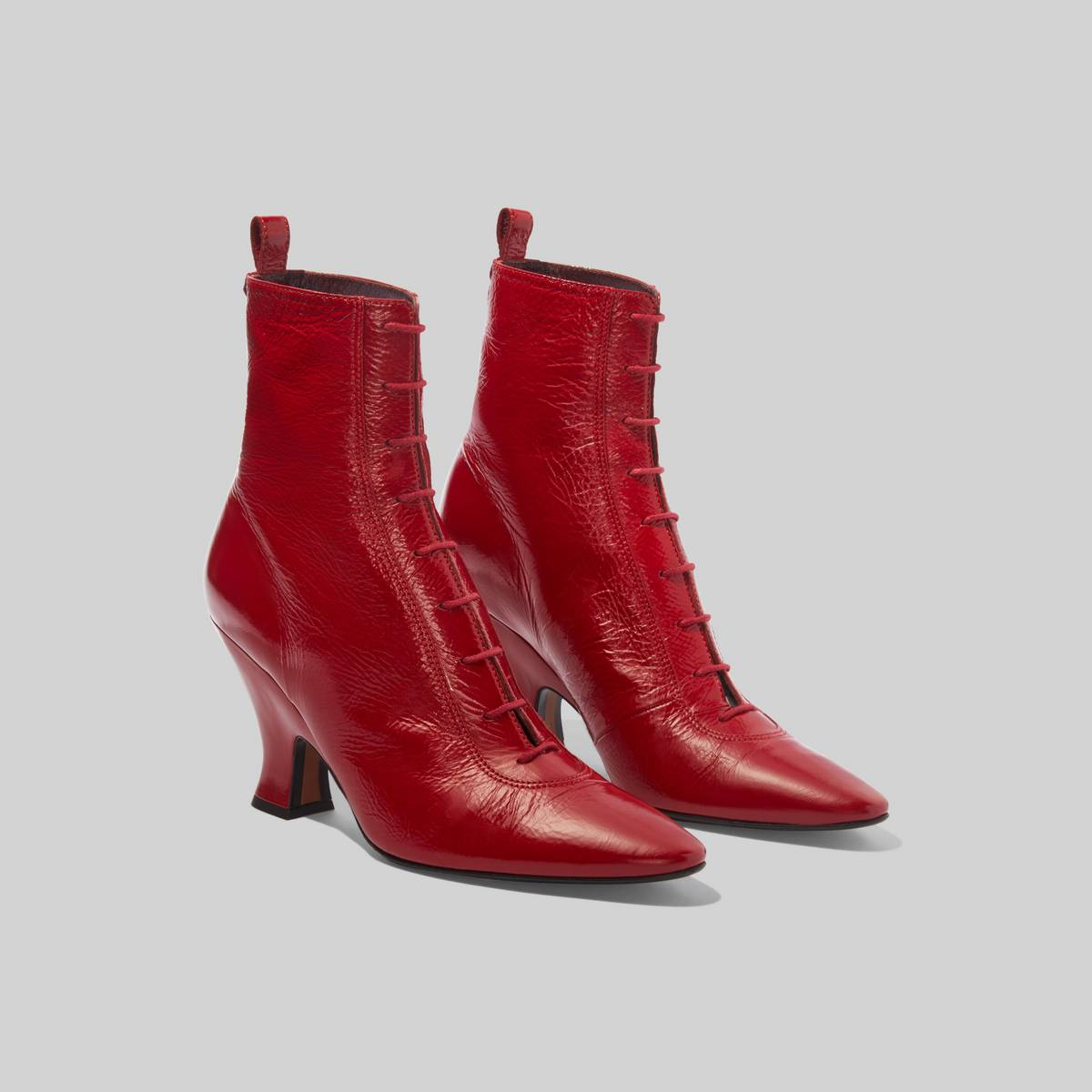 In shiny leather with prim corset lacing and an authentic sculpted vintage silhouette, our reinterpretation of The Victorian Boot walks the line between prim and punk. | MARC JACOBS Women\\'s The Victorian Boots in Red, Size 36