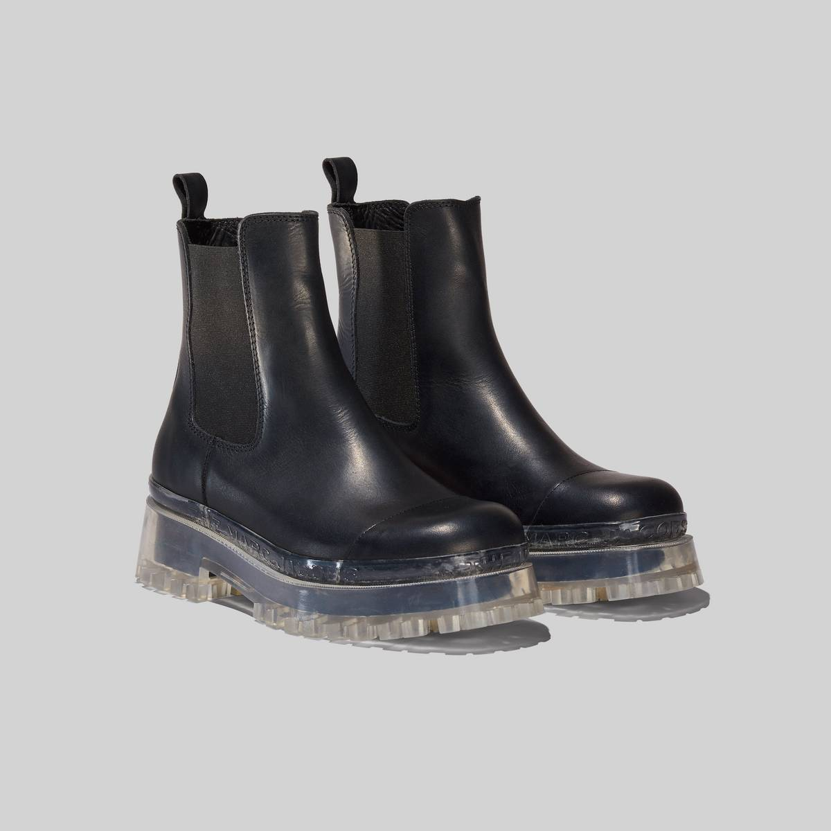 The ultimate chelsea combat boot reimagined with a new transparent rubber sole featuring our signature logo. | MARC JACOBS Women\\'s The Boots in Black, Size 41