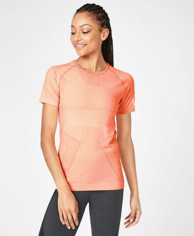 Athlete Mesh Seamless Workout T-Shirt, Passion Coral | Sweaty Betty