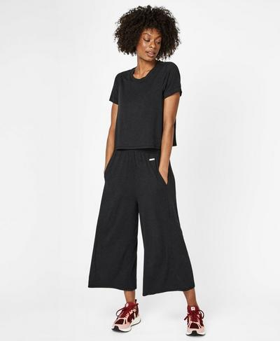 Meditate Culotte Jumpsuit, Black Marl | Sweaty Betty