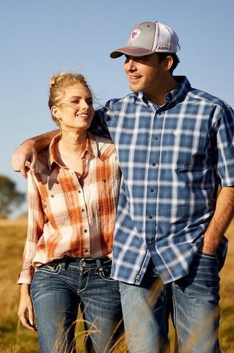 Man and women wearing Ariat clothes in field